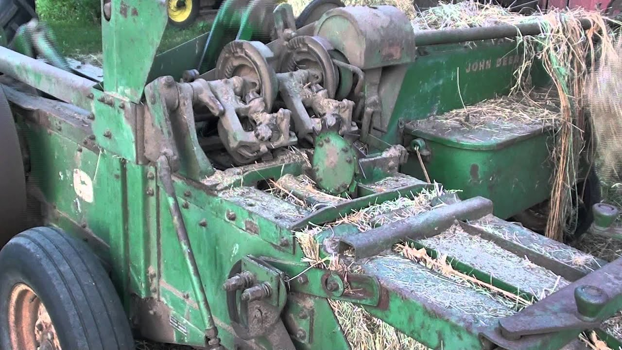 how does a manual tie round baler work